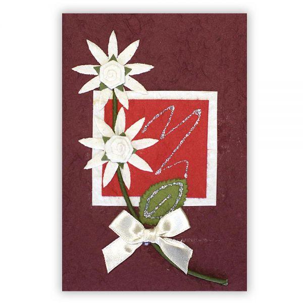 SAA Grußkarte | 2 Sternblüten und weisser Schleife auf rotem Grund